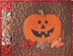 http://www.craftsy.com/pattern/quilting/home-decor/pumpkin-mug-rug-303/32044