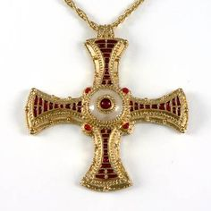 This is the pectoral chest cross that was buried with St Cuthbert who was an Anglo Saxon monk, hermit and bishop. He died in 687.