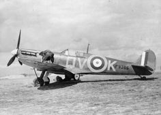 Supermarine Spitfire Mk IA, P9368 'QV-K', of No. 19 Squadron RAF, being rearmed between sorties at Fowlmere, Cambridgeshire. P9368 was often flown by the Commanding Officer, S/L B J E 'Sandy' Lane, and was also the preferred aircraft of 'A' Flight commander F/L W J 'Farmer' Lawson