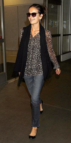 FRENCH CONNECTION TOP  Leopard print feels ultra-luxe especially when it's sheer and on a dark print. But Camilla Belle's French Connection button-up comes with a totally accessible price tag – just $78.