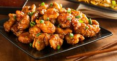 Mouth Watering Orange Chicken Recipe Main Dishes with orange marmalade, low sodium soy sauce, corn starch, fresh ginger, black pepper, salt, orange juice, boneless skinless chicken breasts, olive oil, marinade, sesame seeds, red bell pepper, green onions, red pepper flakes