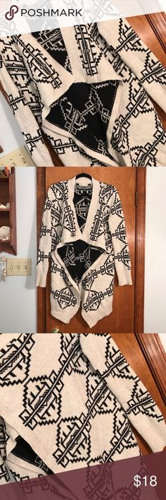 Urban outfitters size large Aztec cardigan! Urban outfitters, size large, Aztec print, long cardigan, tan and black, see third pic for wear, still has a lot of life left !! Urban Outfitters Sweaters Cardigans