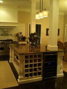built in wine shelf and cooler. my next house must have room in the kitchen for this