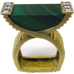 A modernist cocktail ring by La Triomphe. The Yellow gold crossover ribbed shank with malachite flanked by of round white diamonds.Very pretty on . Elegant and Unusual. Gold Diamond Rings, Silver Diamonds, Turquoise Jewelry, Malachite, Vintage Rings, Fashion Rings, Cocktail Rings, Shank, Crossover