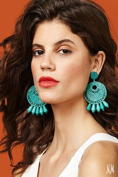 Statement earrings are a key accessorizing piece for spring. Turn up the heat with beaded hoops by Kenneth Jay Lane.