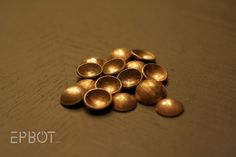 How to make penny buttons/charms for jewelry making.