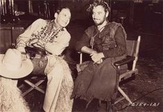 """Ronald Colman and Jack Benny on the set of """" If I Were King """"."""