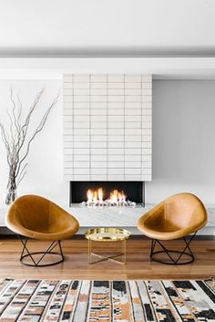 """#hgwomeinindesign Australian Modern, project by interior designer Kim Pearson. """"Gentle, tactile textures create quiet depths and details as foils for the more colourful moments with stone and ceramic clad fireplaces, marble, metal and timber furniture, vintage rugs & leather chairs and exquisite curtains in linens, wools and open weaves."""""""