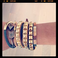 Cartier LOVE bracelet in gold worn by The Man repeller with various arm candy