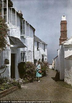 November Devon: A woman admires the flowers outside a cottage in Clovelly. Penguin Books, Color Photography, Vintage Photography, Old Photos, Vintage Photos, Subtractive Color, City Landscape, Great Photographers, London Photos
