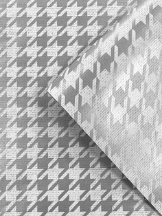 This stylish Houndstooth Wallpaper will add a timeless touch to your home. The classic design features a detailed geometric houndstooth pattern in a metallic silver that has a reflective sheen, contrasting with matte white to create a shiny glistening effect, with subtle fabric detailing throughout. Easy to apply by pasting the wall, this high quality wallpaper will look great when used to decorate a whole room or to create a feature wall.