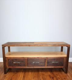 Reclaimed wood entertainment center. Looks classy!
