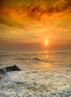 Bali, Indonesia  I just love the mighty Sun coming to death at the feet of the mighty Sea.  Strength bowing to strength !!!