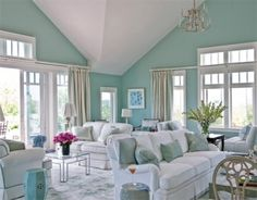 I love the colors, though I'd probably go with beige couches instead of white because of kids.