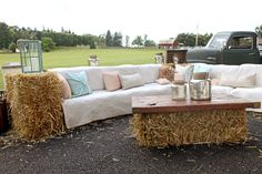 Rustic wedding decor idea - hay bale couch + antique pieces {Jasmine Rose Photography}