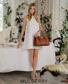 Fashion's darling, Cara Delevingne is giving us 'dreamy chic' when posing for the Spring/Summer 2014 campaign of Mulberry photographed by the imaginative mind of Tim Walker. Get carried away into Mulberry's land of romanticism and fantasy. Cara Delevingne, Look Fashion, Fashion Models, Fashion Outfits, Fashion Design, Fashion Shoes, Daily Fashion, Paris Fashion, Fashion News