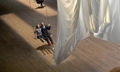 The event of a thread Ann Hamilton's installation at the Park Avenue Armory features 42 swings, whose use by visitors agitates an immense curtain.