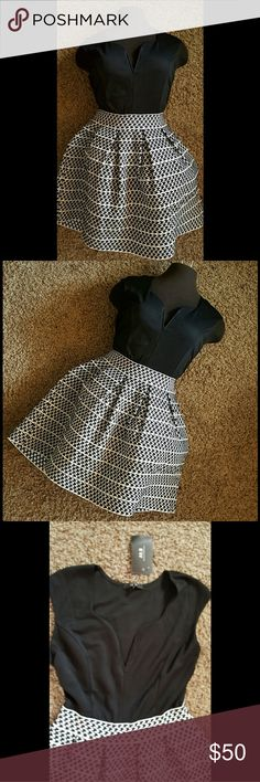 FORM FITTING DRESS!!! NWT black and white Alt.B Dress Size LARGE! Boobalicious and formfitting at the top.This dress gives you a great shape! The bottom half is elastic so it creates a nice waist line and poofs out. Alt.B  Dresses