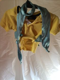 i went to the thrift store and purchased a child's shirt. Blue scarf that had a satin feel to it. to make a pee pee flap for my dog i rolled it up and hot glued it. I cut strips and hot glued the as well to make it look like flounders strips. cost me maybe $4.