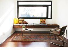 Impressive floating window seat fills entire wall. Nice and minimal, wood does all the talking.