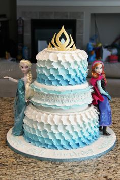 Disney Frozen Birthday Cake! Queen Elsa and Princess Anna dolls. Ombré blue ruffle petals and snowflakes. www.shookupcakes.com