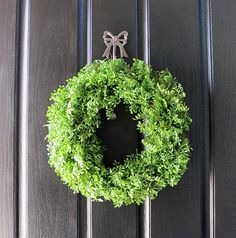 Fake greens on grapevine wreath