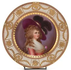 Absolutely gorgeous ~ Dresden ~ Hand painted portrait plate~ Marie Antoinette on a purple to lavender background ~ Outer and inner rim gilt gilded with red beading ~ White border decorated with gold stripes with gold beading ~ Wreath and bow swags ~ Dresden, Germany ~ Circa 1880