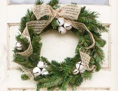 This beautiful rustic bell DIY Christmas wreath is sure to offer a warm welcome to your holiday guests! It's simple to make - we'll show you how!