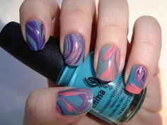 "I recently discovered the nail polish trend that's been sweeping across the Internet on YouTube and Pinterest. This trend is called ""Water Marbling."" The technique is directly implied by the name - you use water to achieve a marbled nail polish look on your nails. - DivineCaroline.com"