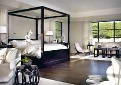 This elegant black and white bedroom was completed by Tom Stringer. #luxeChicago