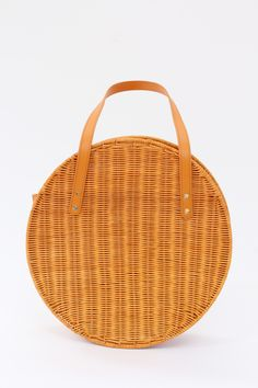 "Large carryall shoulder bag in Italian vegetable-tanned leather and custom wicker hand made in the Philippines. Top opening with two shoulder straps. Handles 16"" long. Height 15"" / Width 15"" / Depth 3"