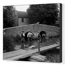 Men at work on river crossing at Eynsford bridge over the River Darent in Kent. Box Canvas Print. Men at work on river crossing at Eynsford bridge ov.