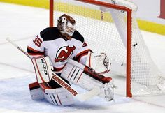 New Jersey Devils goalie Cory Schneider is unable to stop a goal by Florida Panthers center Denis Malgin during the second period of an NHL hockey game, Thursday, Nov. 3, 2016, in Sunrise, Fla. (AP Photo/Alan Diaz)