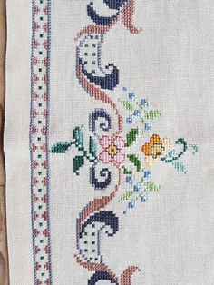 Lovely floral cross stitch embroidered tablecloth in linen