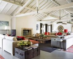 Modern Rustic Interior Design... This has many Elements that remind me of our Great Room...Light Colored Sectionals...The same Multi-Bright Accessories...Nice Room!