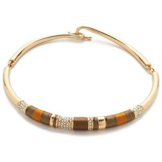"""Our designers wrapped this shiny gold-plated choker with colorful thread that adds instant texture to pretty much anything you wear it with. Length: 16"""". Brass…"""