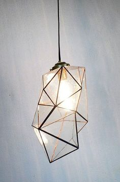 One of my favorite aspects of interior design is lighting, specifically the craftsmanship that goes into the production of pendants. Take a look at this geometric pendant I found on Blood and Champagne