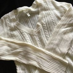 """Aeropostale Off White Cable Sweater Classic look! Lighter weight cable knit sweater that looks brand new. Off White/cream in color. Worn maybe 1-2 times. Measures about 24"""" from top of shoulder to bottom. 90% Acrylic, 10% Angora. Aeropostale Sweaters V-Necks"""