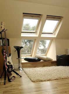 Bring more light into your loft conversion with a double set of roof windows. This is the perfect set-up for a teen room.