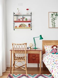 Ivy's bedroom. Tomado shelves from eBay, vintage desk and cane chair, bed linen from Kip & Co. Photo – Eve Wilson. Production – Lucy Feagins / The Design Files.