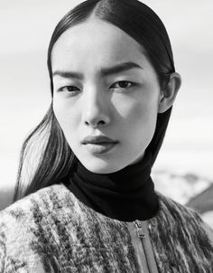 Fei Fei dons a turtleneck look from COS