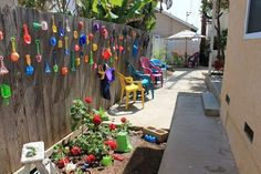 """My neighbor and I call this our """"Toy Garden"""". We spend day after day walking the beach for sea glass and unique shells. After noticing all the beach toys, flip… Outdoor Learning, Outdoor Play, Outdoor Living, Outdoor Decor, Outdoor Spaces, Outdoor Toys, Outdoor Storage, Outdoor Ideas, Garden Globes"""