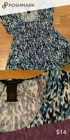 Cute Calvin Klein top Blue Black and white scoop neck with elastic under the bust and barely a sleeve. Great alone or as a layer piece! Calvin Klein Tops Blouses