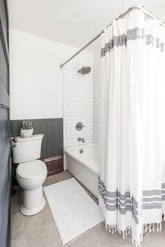 Bathtub with two open sides and subway tile.