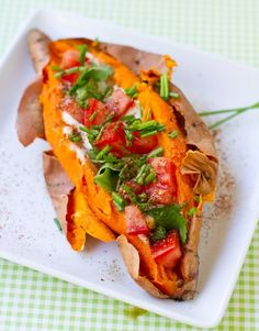 "Simple Stuffed. Skinny Style  1 sweet potato, oven-baked/slit down middle 3/4 cup plain soy yogurt 1/3 cup tomatoes, diced sprinkle of chopped cilantro chopped chives a few dashes of chipotle spice salt/pepper to taste  Not only are sweet potatoes readily available, inexpensive, and delicious but check out the other health benefits this yummy vegetable has! We made up the nickname ""Power 9"" for this sexy veggie!  1. High in vitamin B6 2. Good source of vitamin C 3. Contain vitamin"