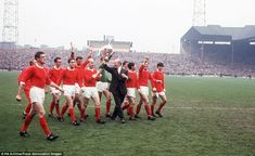 Sir Matt Busby and players celebrate league title in 1967