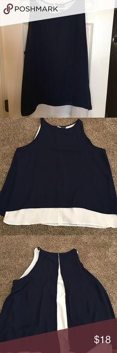 Flowy Two-Toned Tank I listed photos of top on the floor to show how flowy it is. The back has a slit down the middle to show white fabric underneath. 100% polyester. Worn twice. Tag lists as XL, I'd say it's more accurate for a L. Tops Tank Tops