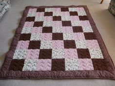 This is a beautiful single quilt made with quilting flannels for the front and minky on the back to make it so soft and cuddly to roll up in. http://3bquiltingandfabric.com/single-brown-pink-flannel-minky-quilt/# (403) 625-4821