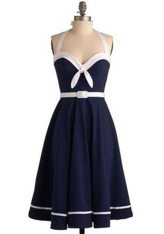Pretty nautical dress...I love nautical themes clothes and navy, white, and red...and I don't even live by the sea...
