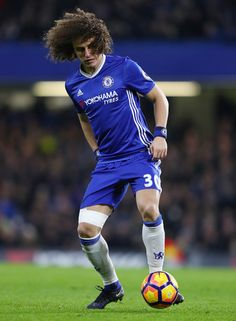 David Luiz of Chelsea in action during the Premier League match between Chelsea and Stoke City at Stamford Bridge on December 31, 2016 in London, England.